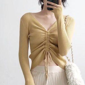 Trendy light yellow drawstring sweater crop top